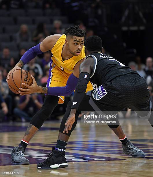 Angelo Russell of the Los Angeles Lakers looks to put a move on Darren Collison of the Sacramento Kings during an NBA basketball game at Golden 1...