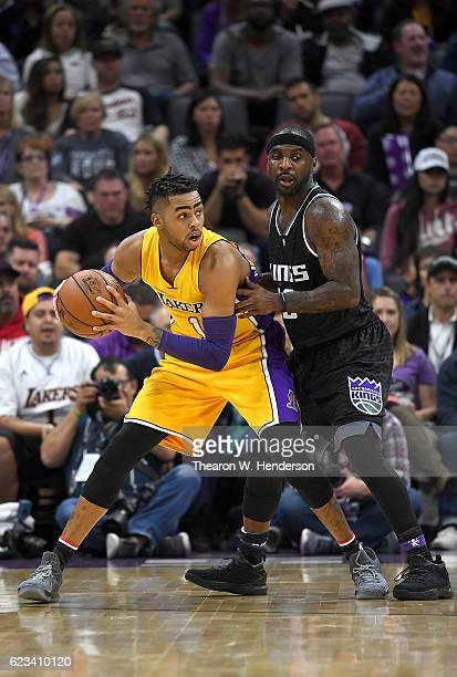 Angelo Russell of the Los Angeles Lakers looks to put a move on Ty Lawson of the Sacramento Kings during an NBA basketball game at Golden 1 Center on...