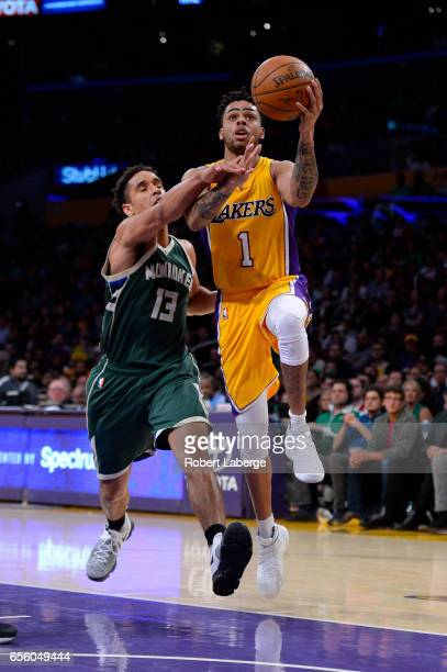 Angelo Russell of the Los Angeles Lakers plays against Malcolm Brogdon of the Milwaukee Bucks on March 17 2017 at STAPLES Center in Los Angeles...