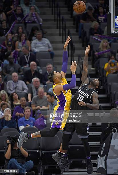 Angelo Russell of the Los Angeles Lakers shoots over Ty Lawson of the Sacramento Kings during an NBA basketball game at Golden 1 Center on November...