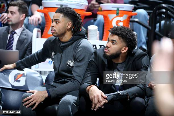 Angelo Russell of the Minnesota Timberwolves and Karl-Anthony Towns of the Minnesota Timberwolves look on during a game against the Charlotte Hornets...