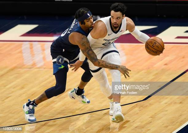 Angelo Russell of the Minnesota Timberwolves defends against Dillon Brooks of the Memphis Grizzlies during the first quarter of the game at Target...