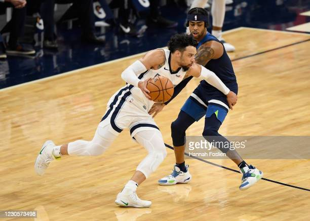 Angelo Russell of the Minnesota Timberwolves defends against Dillon Brooks during the first quarter of the game at Target Center on January 13, 2021...