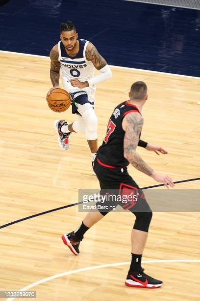 Angelo Russell of the Minnesota Timberwolves dribbles the ball while Daniel Theis of the Chicago Bulls defends in the first quarter of the game at...