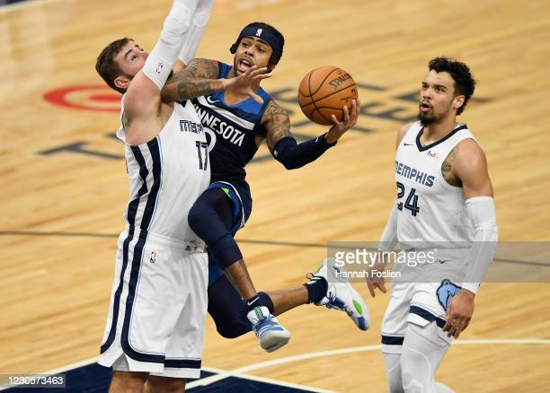 Angelo Russell of the Minnesota Timberwolves shoots the ball Jonas Valanciunas and Dillon Brooks of the Memphis Grizzlies during the first quarter of...