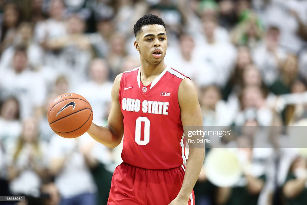 D'Angelo Russell #0 of the Ohio State Buckeyes dribbles the ball during the second half against the Michigan State Spartans at the Breslin Center on February 14, 2015 in East Lansing, Michigan.