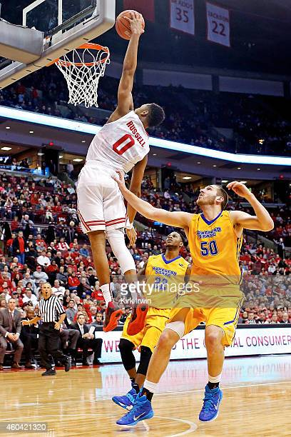 Angelo Russell of the Ohio State Buckeyes dunks the ball while being guarded by Billy Reader of the Morehead State Eagles during the second half at...