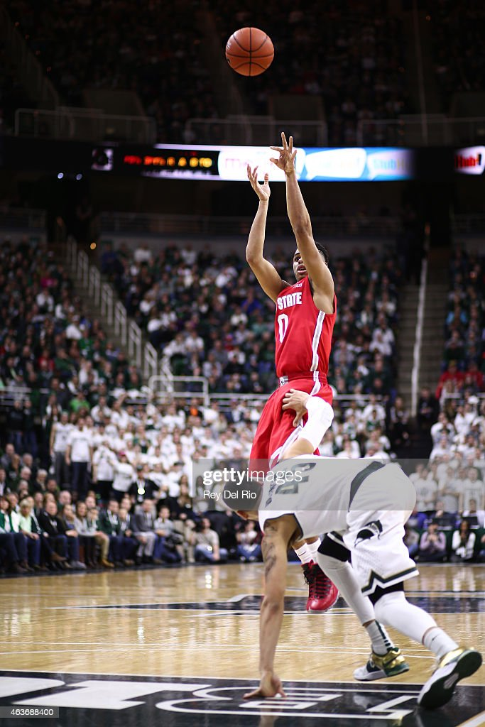 D'Angelo Russell #0 of the Ohio State Buckeyes shoots over Denzel Valentine #45 of the Michigan State Spartans at the Breslin Center on February 14, 2015 in East Lansing, Michigan.