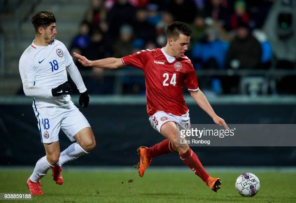 Angelo Sagal of Chile and Jonas Knudsen of Denmark compete for the ball during the International friendly match between Denmark and Chile at Aalborg...
