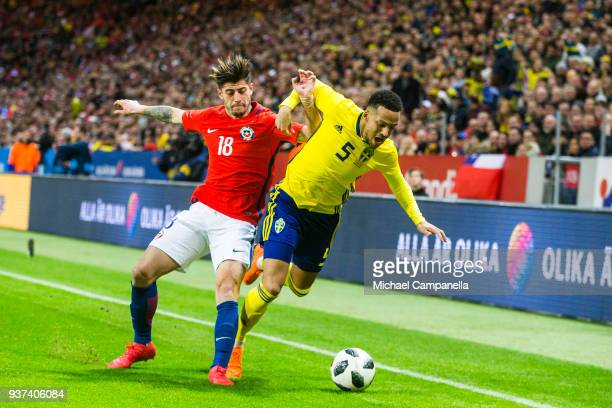 Angelo Sagal of Chile and Martin Olsson of Sweden battle for the ball during an international friendly between Sweden and Chile at Friends arena on...