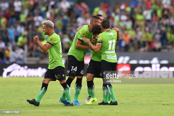 Angelo Sagal of Juarez celebrates with teammates after scoring the second goal of his team during the 3rd round match between FC Juarez and Toluca as...