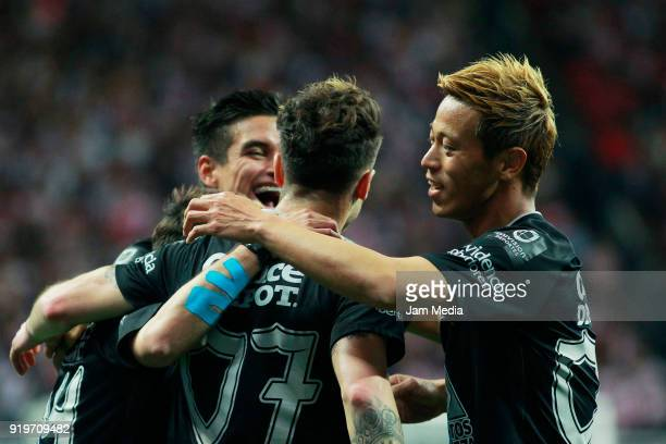 Angelo Sagal of Pachuca celebrates with teammate Keisuke Honda after scoring the first goal of his team during on the 8th round match between Chivas...