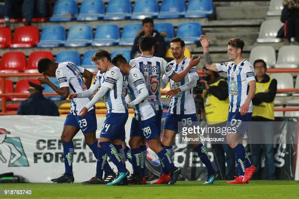 Angelo Sagal of Pachuca celebrates with teammates after scoring the first goal of his team during the 7th round match between Pachuca and Tijuana as...