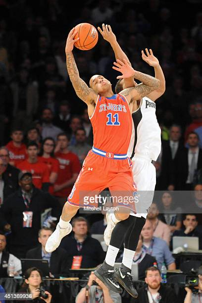 Angelo Sampson of the St John's Red Storm pulls down a rebound during the Big East Men's Basketball Quarterfinal Round game against the Providence...