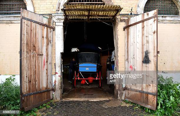 Angelo Sed president of the Romans horsedrawn carriage drivers and his horse 'Inventore' arrive at the stable after a day of work on October 2 2014...