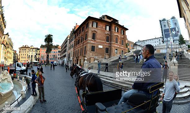 Angelo Sed president of the Romans horsedrawn carriage drivers and his horse 'Inventore' passes in front of the Spanish Steps at Piazza di Spagna on...