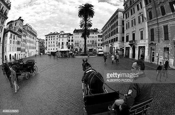 Angelo Sed president of the Romans horsedrawn carriage drivers and his horse Inventore arrive at Piazza di Spagna on October 2 2014 in Rome The...