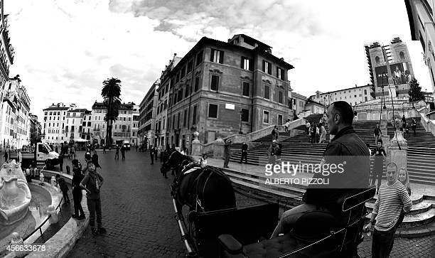 Angelo Sed president of the Romans horsedrawn carriage drivers and his horse Inventore passes in front of the Spanish Steps at Piazza di Spagna on...