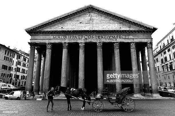 Angelo Sed president of the Romans horsedrawn carriage drivers and his horse 'Inventore' wait for clients in front of the Pantheon on October 2 2014...