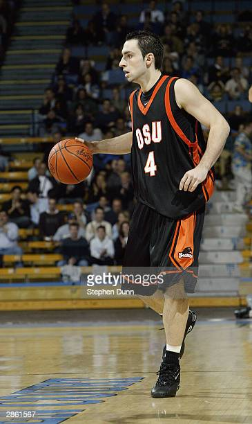 Angelo Tsagarakis of the Oregon State Beavers moves the ball during the game against the UCLA Bruins on January 2 2004 at Pauley Pavillion in...
