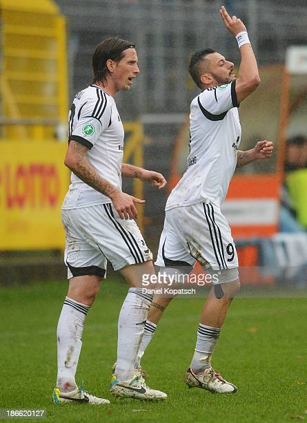 Angelo Vaccaro of Elversberg celebrates his team's first goal with team mate Lukas Billick during the Third League match between SV Elversberg and...