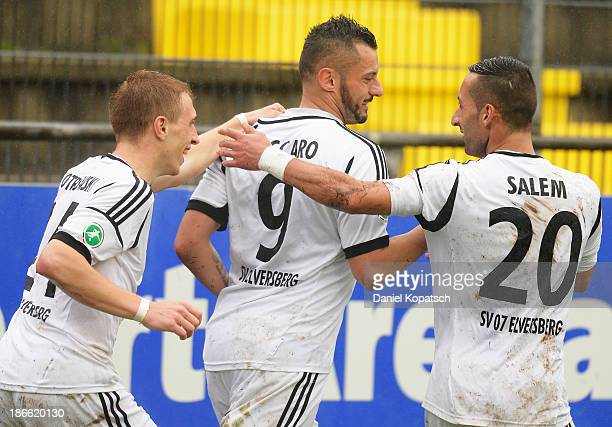 Angelo Vaccaro of Elversberg celebrates his team's first goal with team mates Sebastian Pitrowski and Milad Salem during the Third League match...