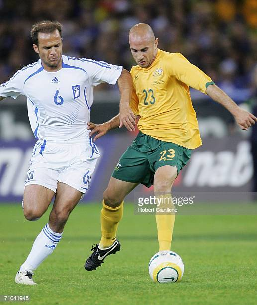 Angelos Basinas of Greece challenges Marco Bresciano of Australia during the Powerade Cup international friendly match between Australia and Greece...
