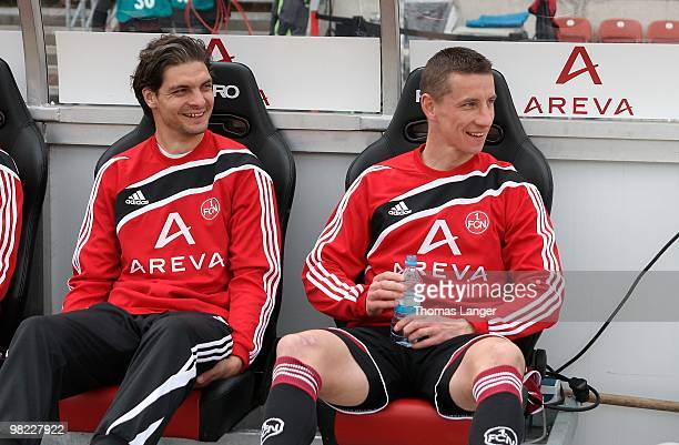 Angelos Charisteas and Marek Mintal of Nuernberg are sitting on the bench prior to the Bundesliga match between 1 FC Nuernberg and FSV Mainz 05 at...