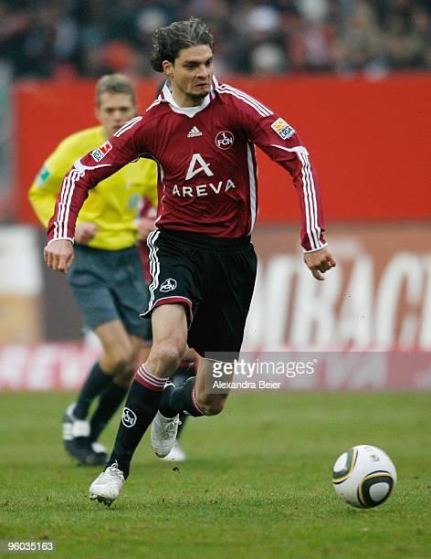 Angelos Charisteas of 1 FC Nuernberg kicks the ball during the Bundesliga match between 1 FC Nuernberg and Eintracht Frankfurt at Easy Credit Stadium...