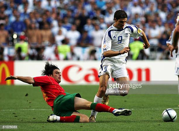 Angelos Charisteas of Greece and Nuno Valente of Portugal during the UEFA Euro 2004 Final match between Portugal and Greece at the Luz Stadium on...