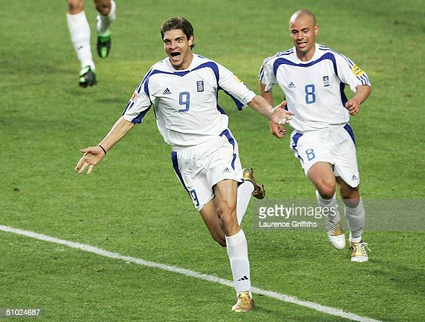 Angelos Charisteas of Greece celebrates scoring their first goal during the UEFA Euro 2004 Final match between Portugal and Greece at the Luz Stadium...