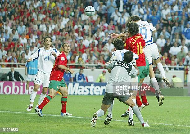Angelos Charisteas of Greece scores the first goal during the UEFA Euro 2004 Final match between Portugal and Greece at the Luz Stadium on July 4...