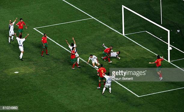 Angelos Charisteas of Greece scores their winning goal during the UEFA Euro 2004 Final match between Portugal and Greece at the Luz Stadium on July...
