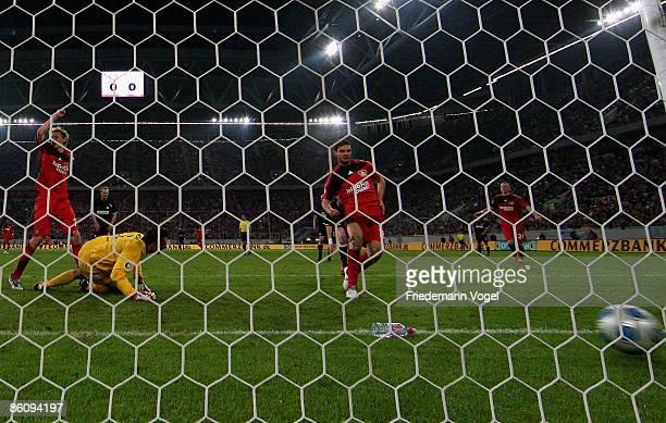 Angelos Charisteas of Leverkusen scores the first goal during the DFB Cup Semi Final match between Bayer 04 Leverkusen and FSV Mainz 05 at the LTU...