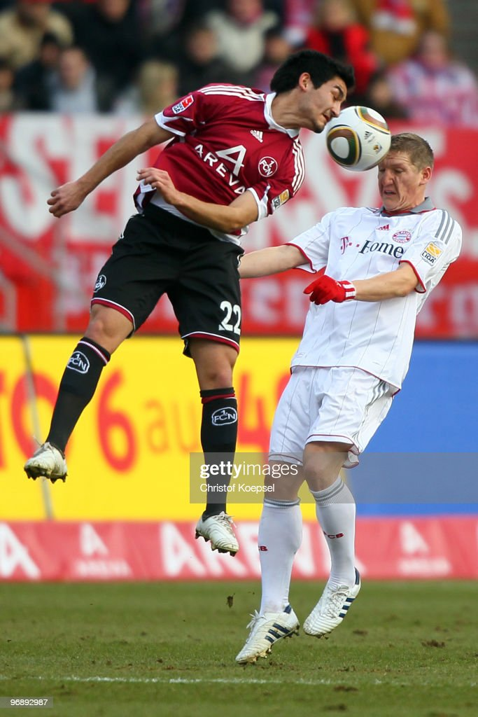 Angelos Charisteas of Nuernberg and Bastian Schweinsteiger of Bayern jump for a header during the Bundesliga match between 1. FC Nuernberg and FC Bayern Muenchen at Easy Credit Stadium on February 20, 2010 in Nuremberg, Germany.