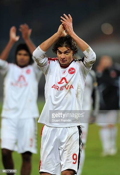 Angelos Charisteas of Nuernberg celebrates his team's victory at the end of the Bundesliga match between Hannover 96 and FC Nuernberg at AWDArena on...