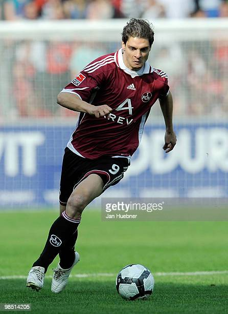 Angelos Charisteas of Nuernberg runs with the ball during the Bundesliga match between SC Freiburg and 1FC Nuernberg at Badenova Stadium on April 17...