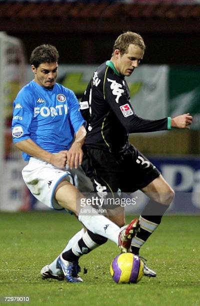 Angelos Charisteas of Rotterdam in action with Petri Pasanen of Bremen during the Efes Pilsen Cup match between Werder Bremen and Feyenoord Rotterdam...