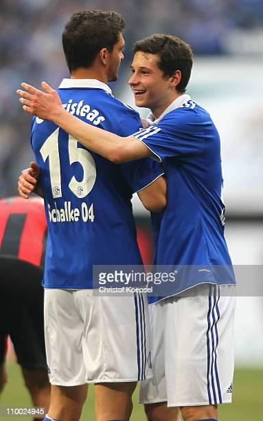 Angelos Charisteas of Schalke and Julian Draxler of Schalke celebrate the 21 victory after the Bundesliga match between FC Schalke 04 and Eintracht...