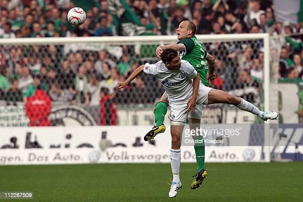 Angelos Charisteas of Schalke and Petri Pasanen of Bremen go up for a header during the Bundesliga match between SV Werder Bremen and FC Schalke 04...