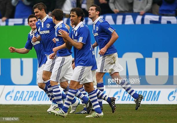 Angelos Charisteas of Schalke celebrates the second goal with Kyriakos Papadopoulos of Schalke and Julian Draxler of Schalke during the Bundesliga...