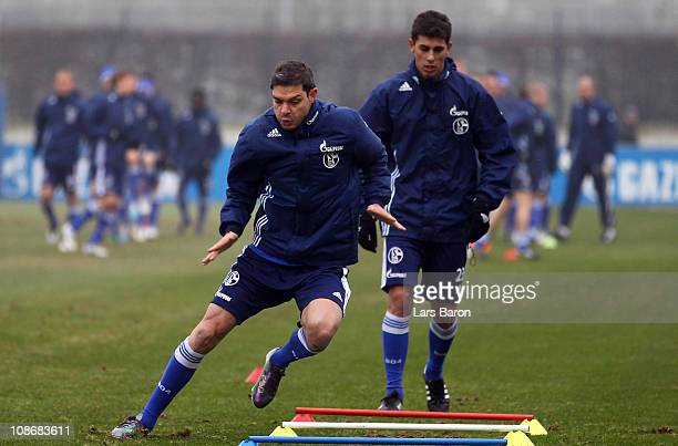 Angelos Charisteas warms up with team mate Danilo Avelar during a FC Schalke 04 training session at Schalke 04 training ground on February 1 2011 in...