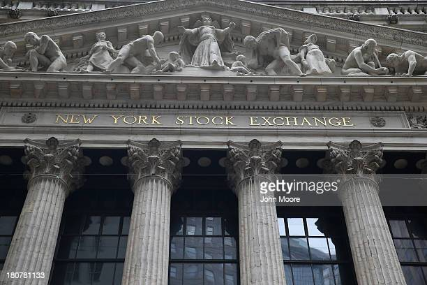 Angels and puties adorn the fascade of the New York Stock Exchange stands on September 16 2013 in New York City Five years after the beginning of the...