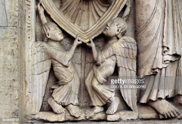 Angels detail from Stories of Genesis by Wiligelmus marble basrelief facade of the Metropolitan Cathedral of Saint Mary of the Assumption and Saint...