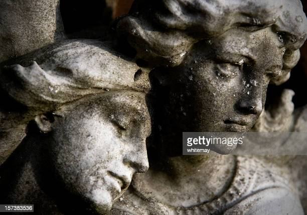 Angels' faces carved in stone