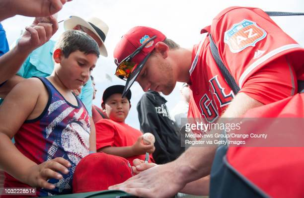 Angels first round draft pick Taylor Ward signs autographs before the Angels game at Tempe Diablo Stadium Thursday INFO angels0304kjs Photo by KEVIN...