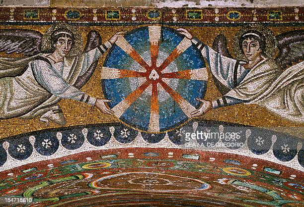Angels holding up a christological monogram mosaic extrados of the triumphal arch apse Basilica of San Vitale Ravenna EmiliaRomagna Detail Italy 6th...