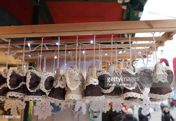 KYIV UKRAINE DECEMBER 14 2019 Angels made of Hessian fabric are displayed at a souvenir stall at the Christmas market in Sofiiska Square Kyiv capital...