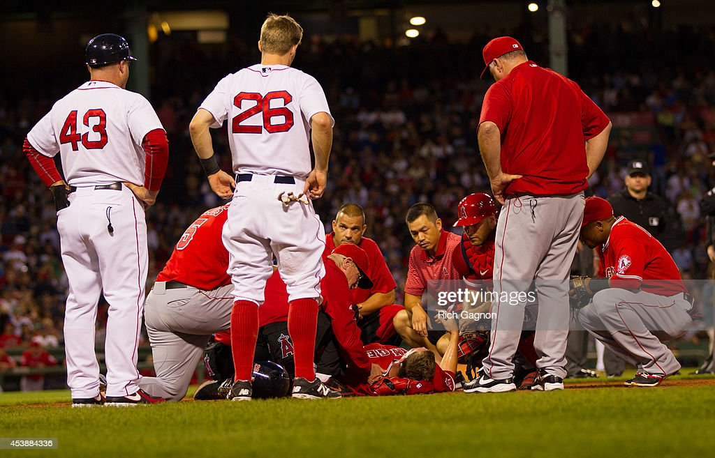Angels Manager Mike Scioscia checks Garrett Richards #43 of the Los Angeles Angels of Anaheim after Richards suffered a leg injury against the Boston Red Sox during the second inning at Fenway Park on August 20, 2014 in Boston, Massachusetts.