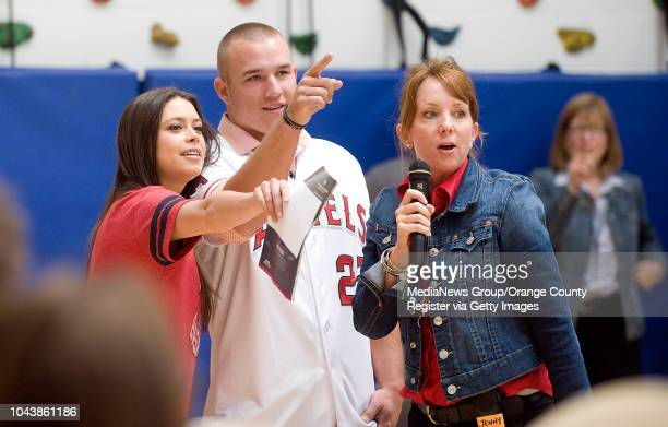 Angels outfielder Mike Trout chooses the winners of a pretzel eating contest with Alex Curry left host of Angels Weekly and Thurston Middle School...